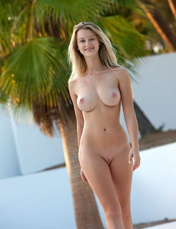 Busty blonde posing nude