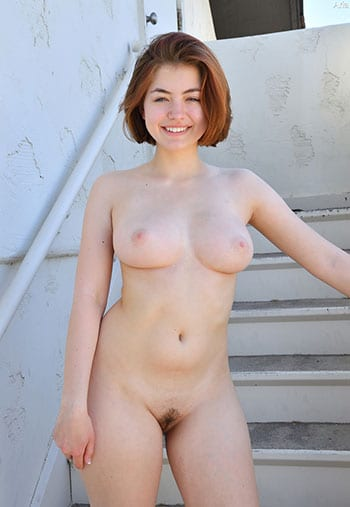 Cute redhead with big boobs outdoors